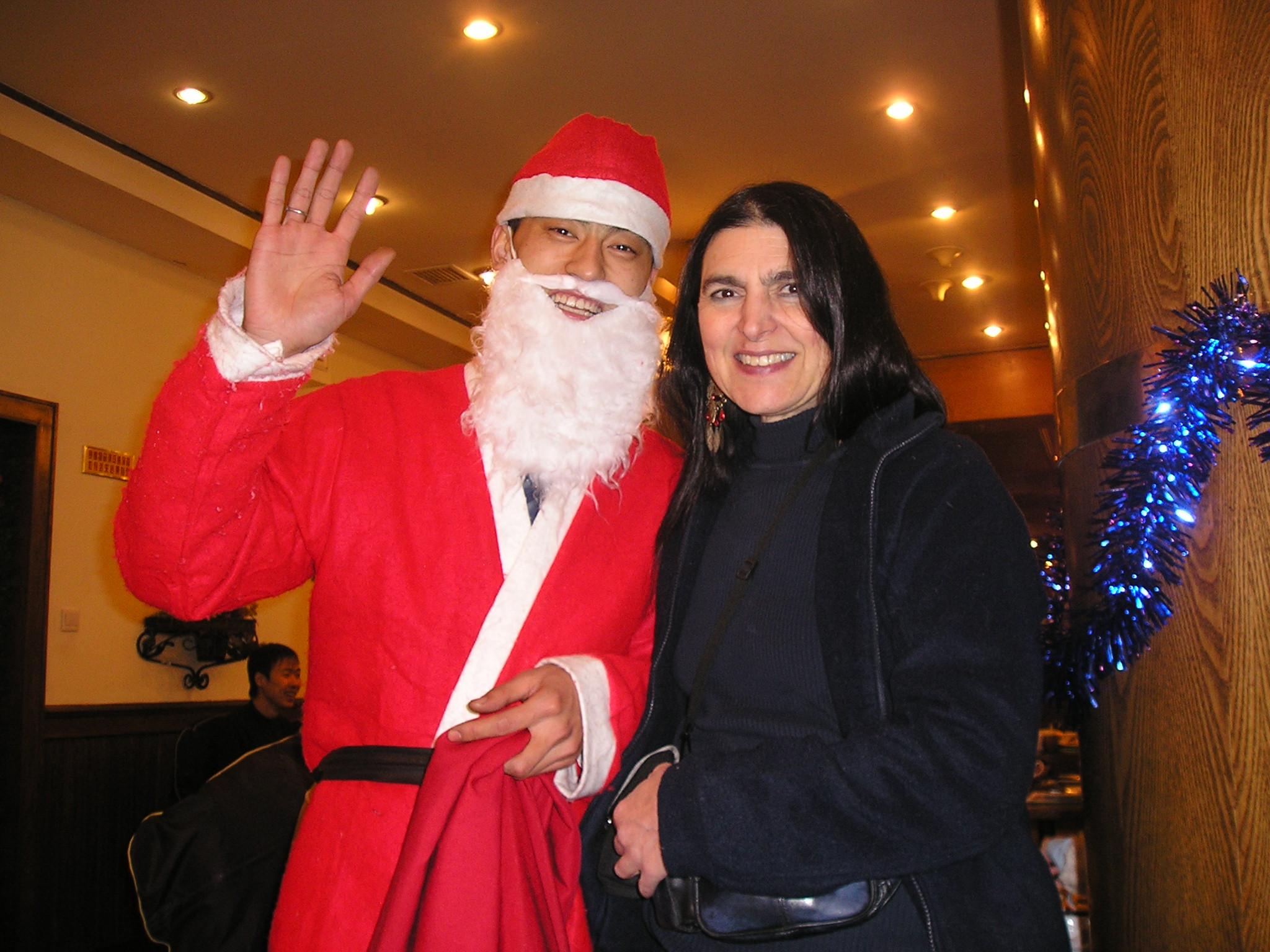 Ramona McKean and Santa server at Hans Beer BBQ in Harbin, Christmas 2004