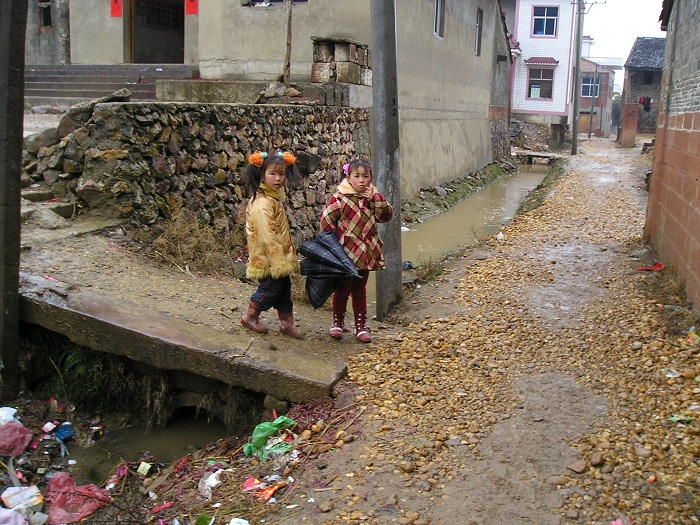 Little gals in a poor Chinese village adorned in their new Spring Festival clothes!