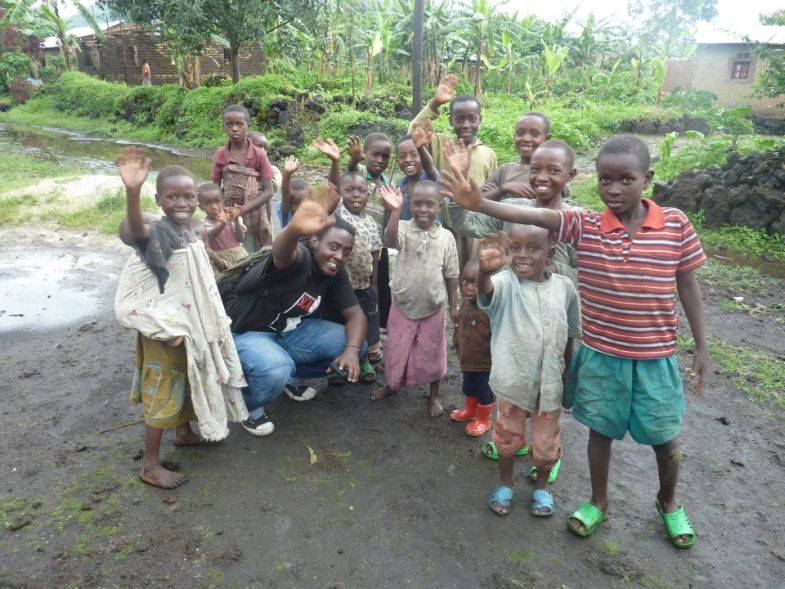 Omy K with Rwandan children