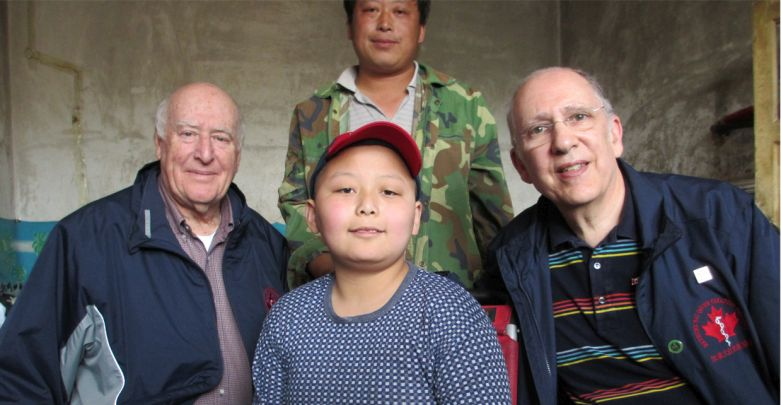 Dr. Grant Stewart, retired trauma surgeon from Vancouver, and Dr. John Ducas, cardiologist from Winnipeg, with Zhen Yi and his dad in 2012